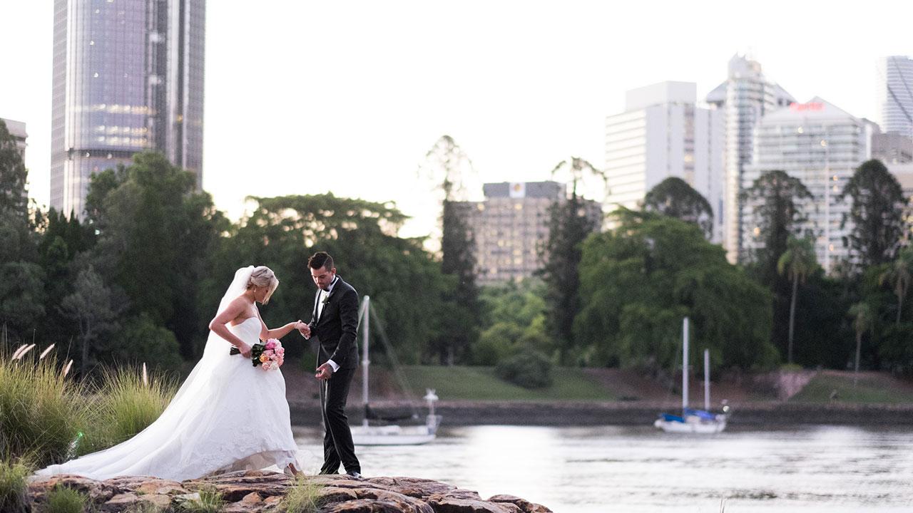 Keller helps his new bride navigate the rocks.