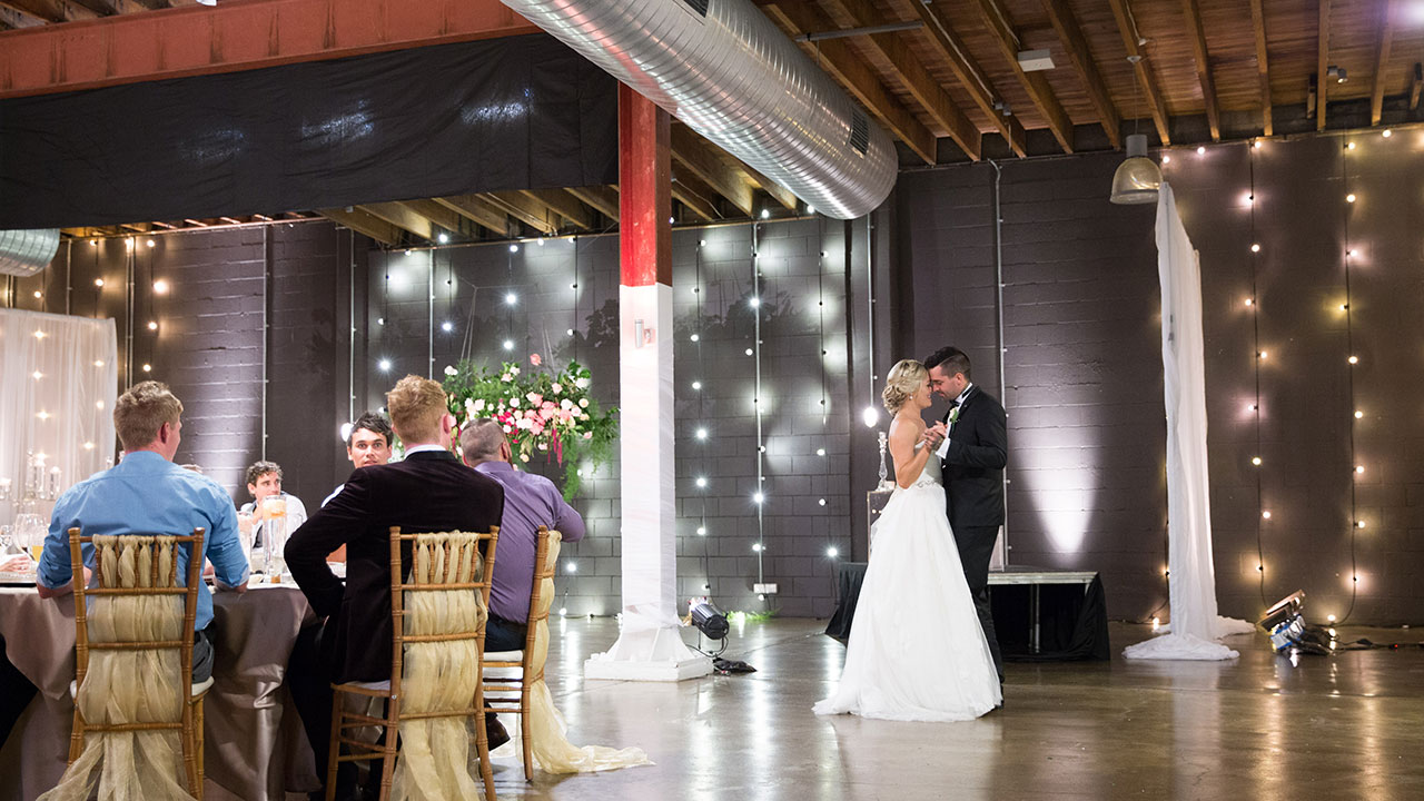 The new couple take their first dance.