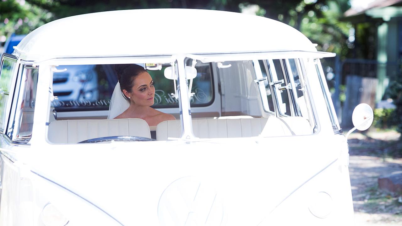 Monica waits in her bridal Kombi.
