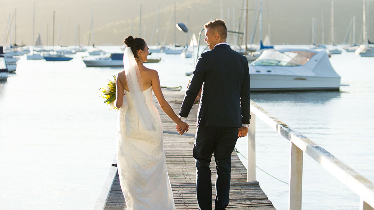 The new couple take a stroll down the picturesque pier.