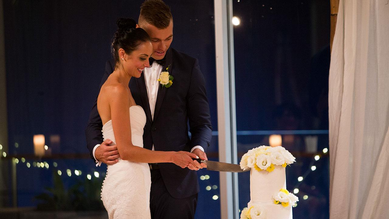 Monica and Mark cut their wedding cake.