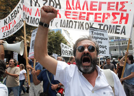 A demonstrator shouts anti government slogans in Thessaloniki, Greece. (AAP)