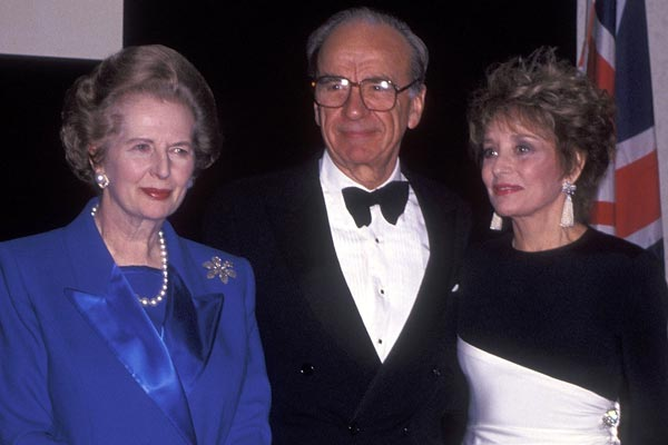 Murdoch with Margaret Thatcher and Barbara Walters in 1991. (Getty)