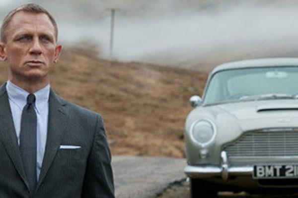 Daniel Craig as James Bond with Aston Martin
