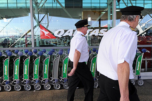 Qantas pilots arriving for work