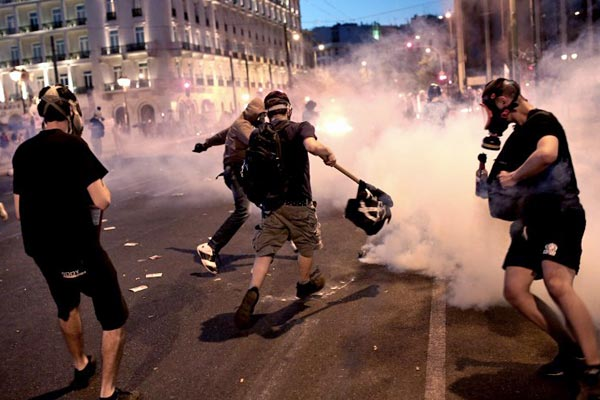 Anti-austerity protesters hurled petrol bombs at police in front of Greece's parliament. (AFP)