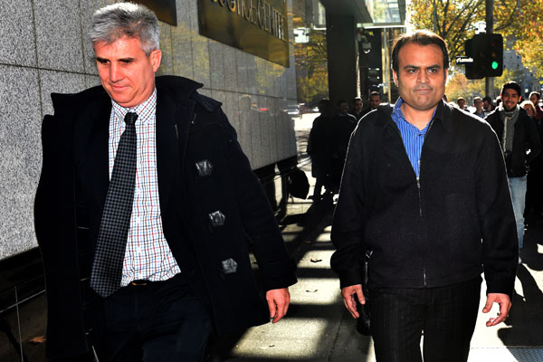 PanKaj Oswal (right) leaving Melbourne's Supreme Court (AAP)