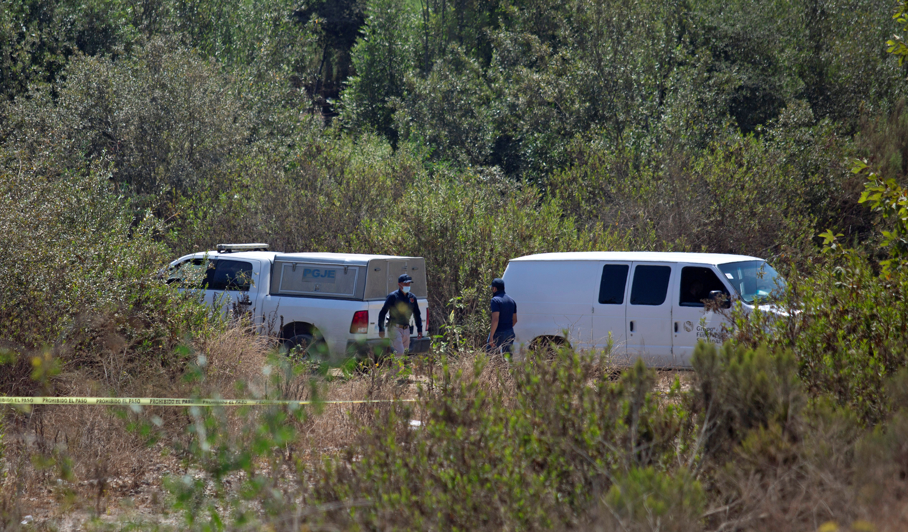 Forensic technicians work at the scene where two young American children were found dead, in Rosarito, Baja California state, Mexico August 9, 2021. Picture taken August 9, 2021. REUTERS/Stringer NO RESALES. NO ARCHIVES