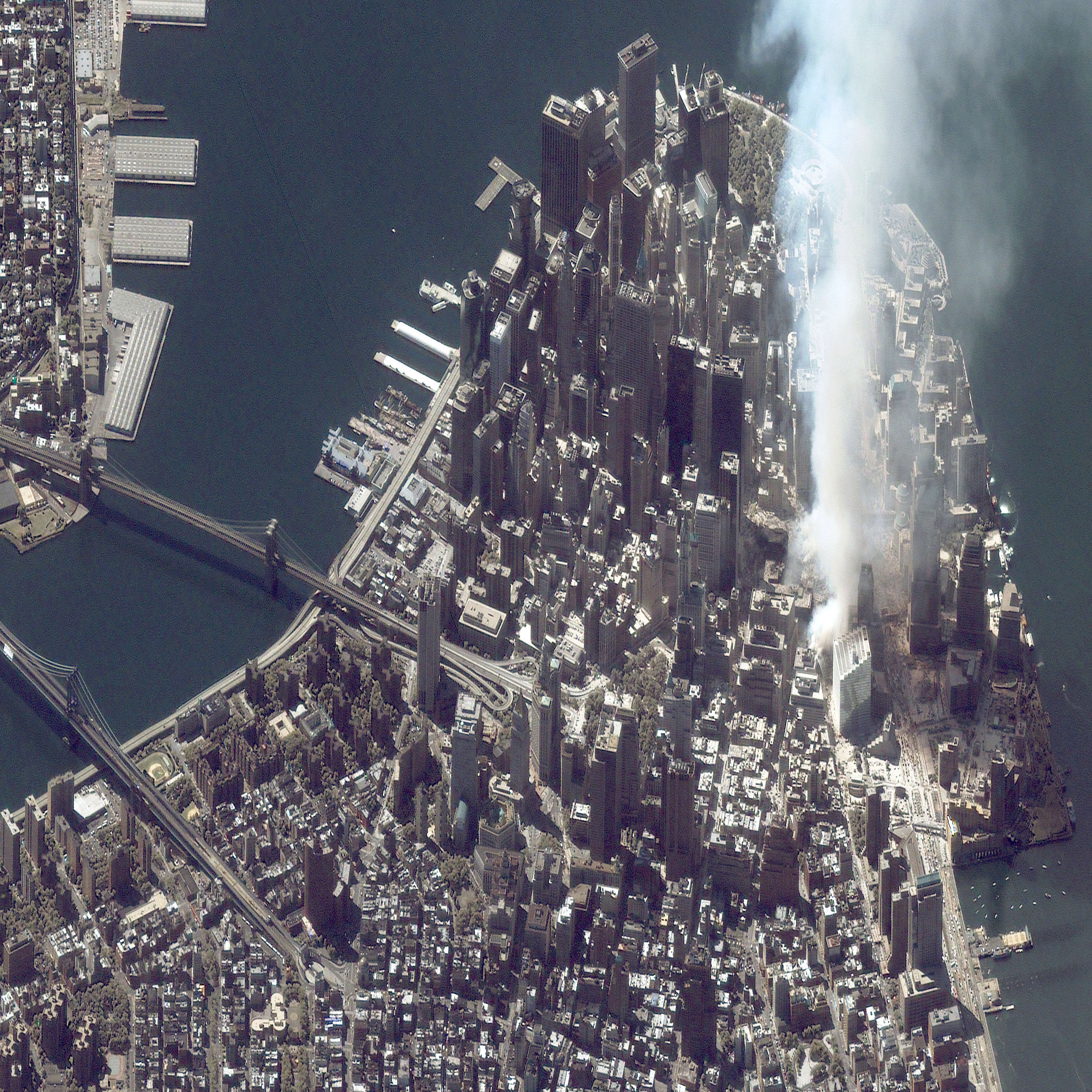 A satellite image of lower Manhattan shows smoke and ash rising from the site of the World Trade Center the day after the September 11 attacks.