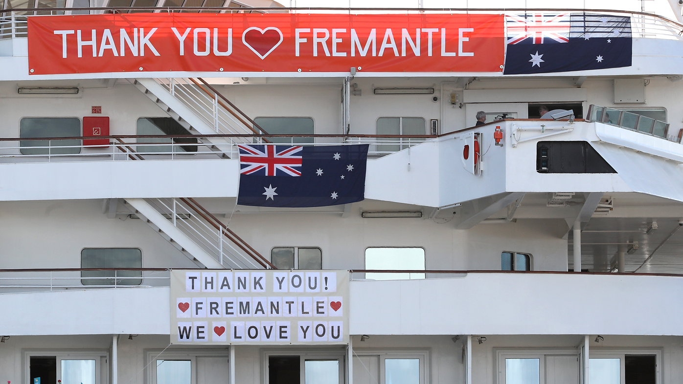 """The MV Artania is seen with """"Thank You Fremantle"""" banners and Australian flags positioned on the side of the vessel while berthed at the Fremantle Passenger Terminal"""
