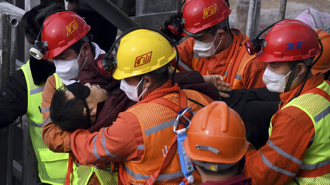Trapped Chinese miners rescued after two weeks
