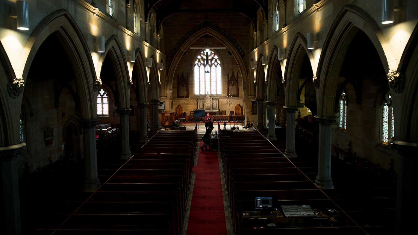 Minister Mike Hastie records a church service to be streamed at Newtown Anglican Church in Sydney.