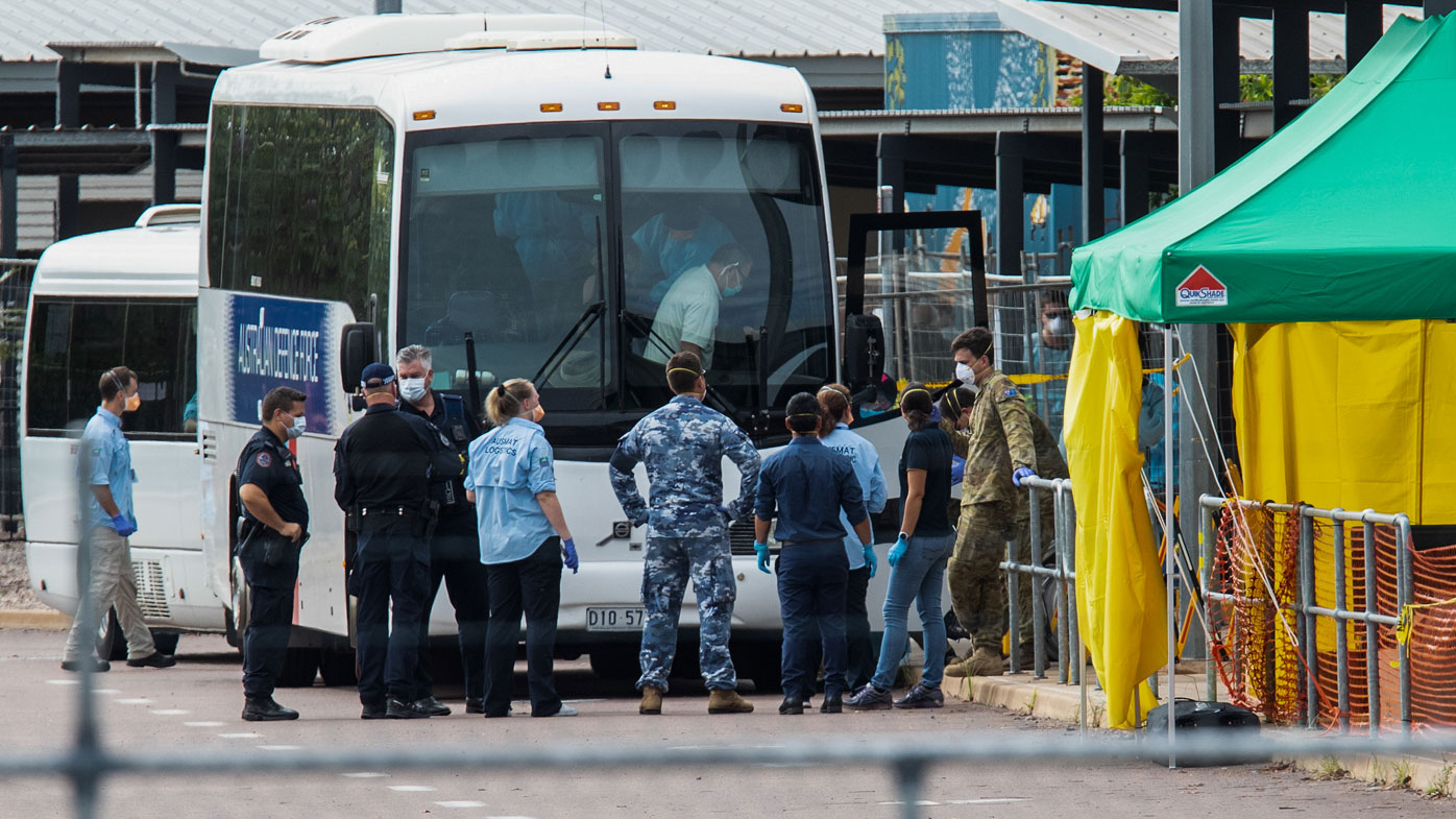 Multiple government agencies gather beside buses to take Australian evacuees from the coronavirus-struck cruise ship ... <a target=