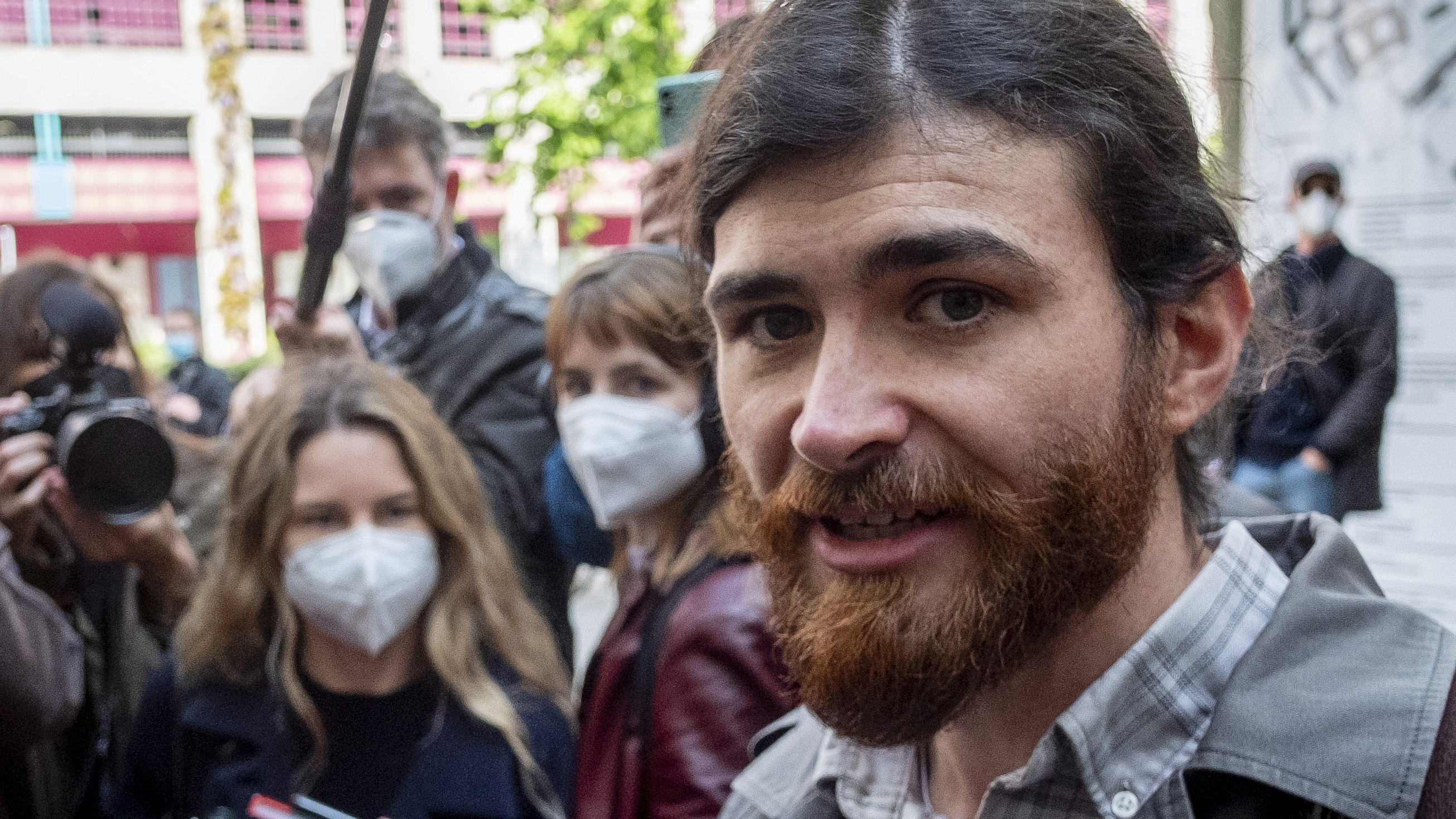 The defendant identified only as 1st Lt. Franco A. due to German privacy rules, walks to a court for the start of a trial on charges of preparing a serious act of violence endangering the state in Frankfurt, Germany.