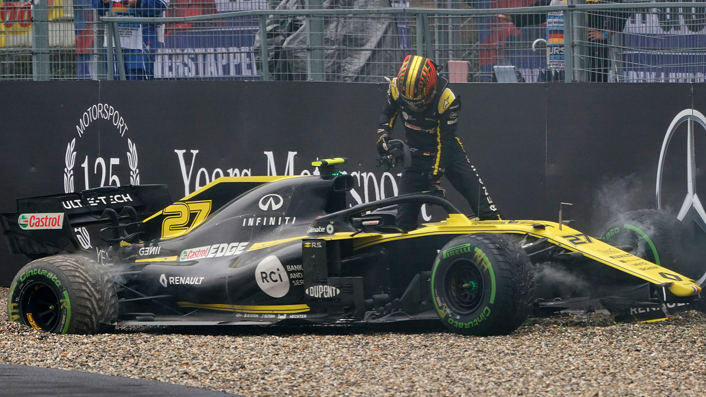 Nico Hulkenberg climbs out of his crashed Renault at the German Grand Prix.