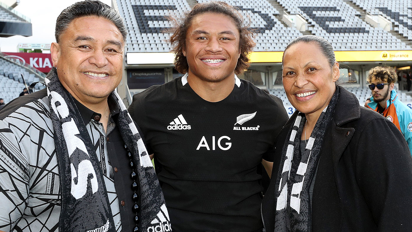 Caleb Clarke of the New Zealand All Blacks (C) meets with his father and former All Black Eroni Clarke (L) and mum Siala Clarke (R)