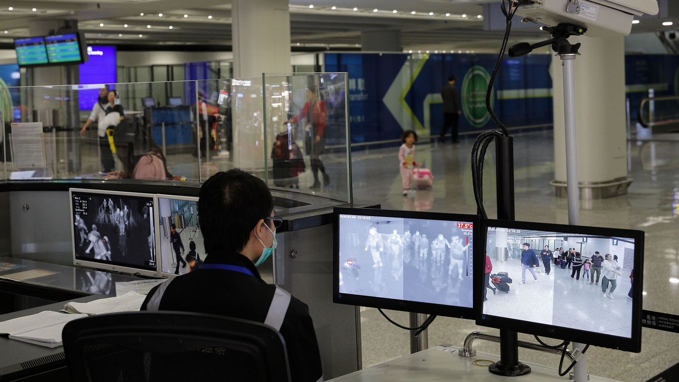Scanners at Hong Kong airport detect if people are feverish.