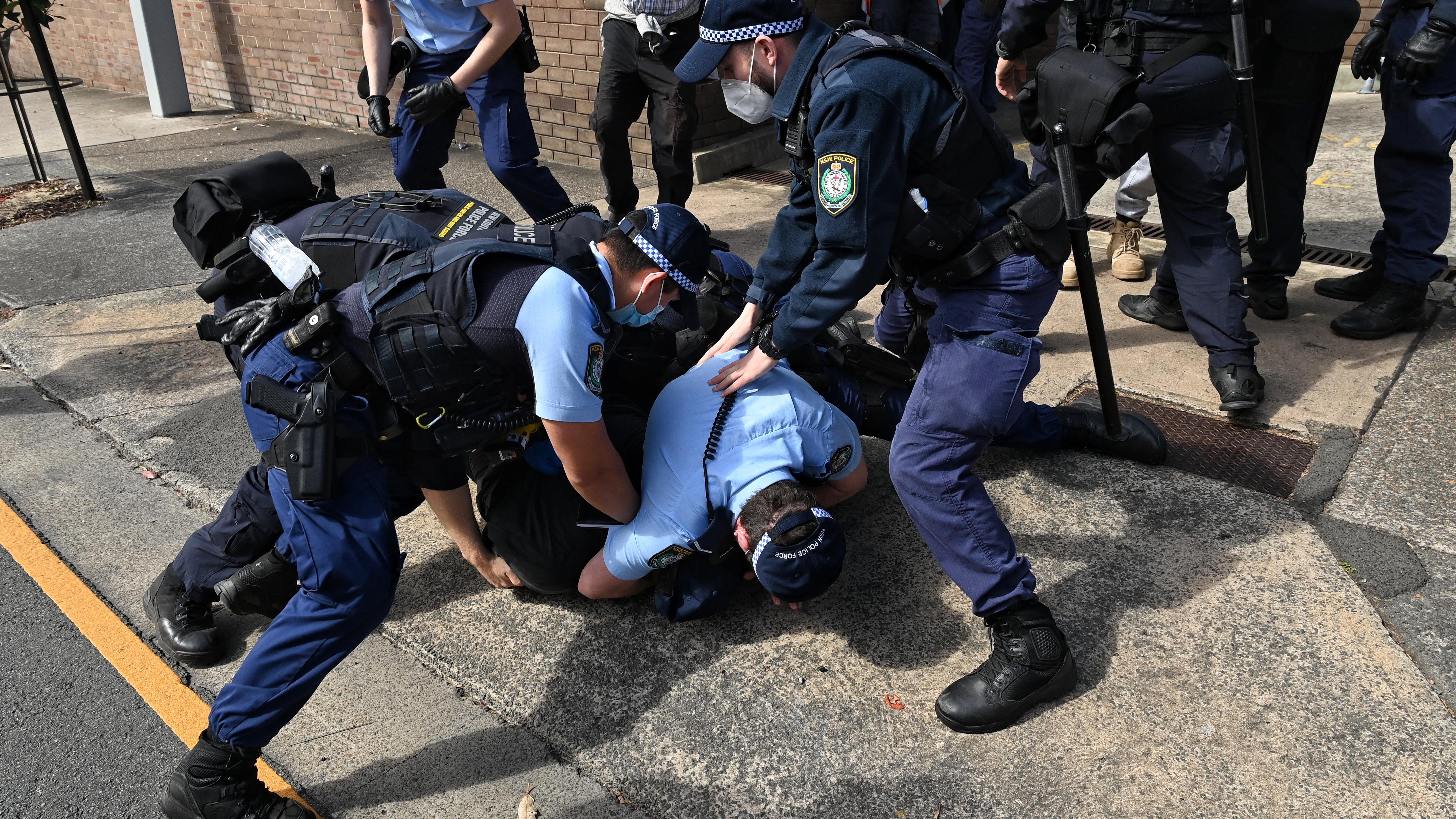 Police arrest protestors at Victoria Park in Sydney.