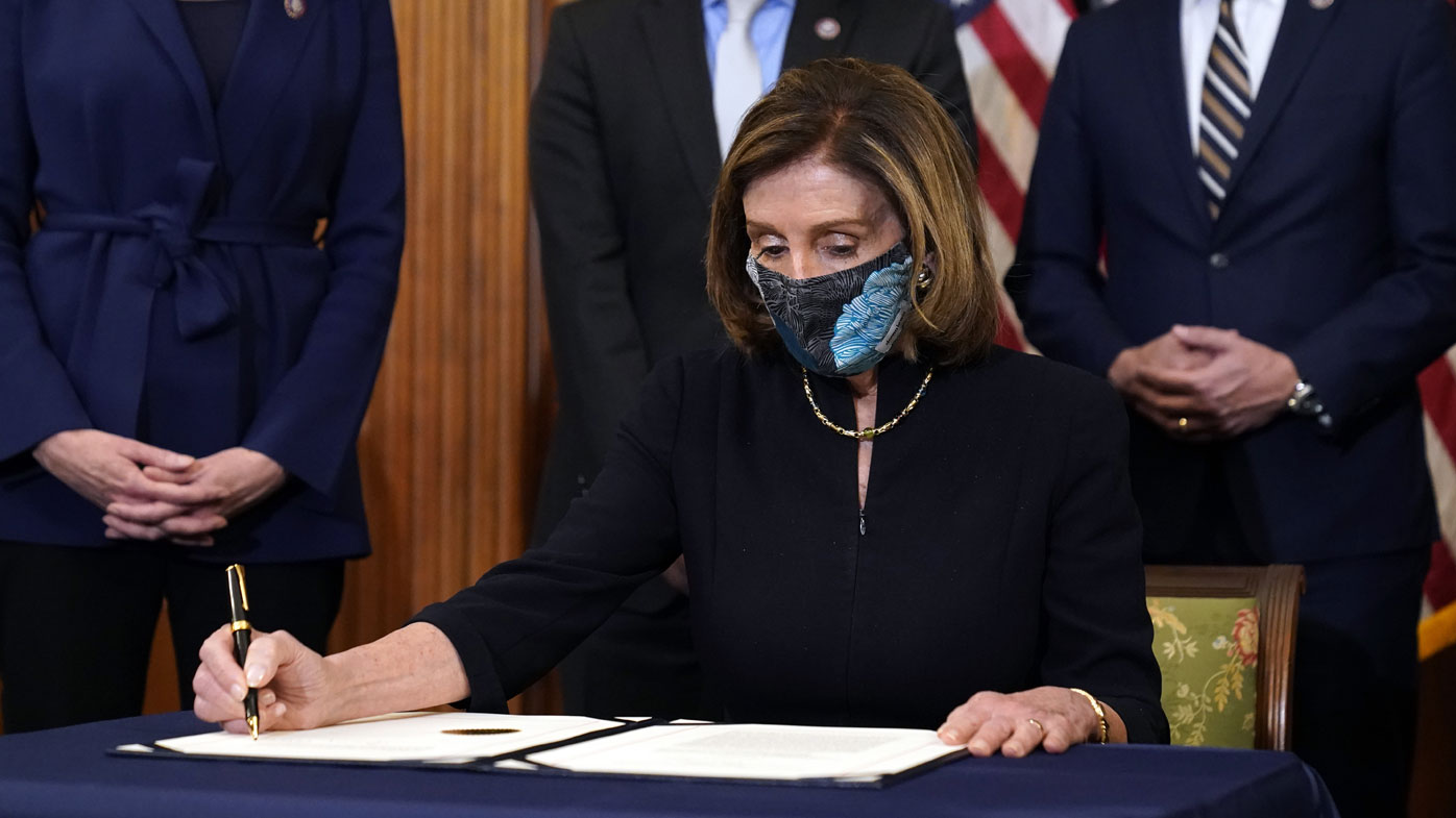 House Speaker Nancy Pelosi signing the articles of impeachment.