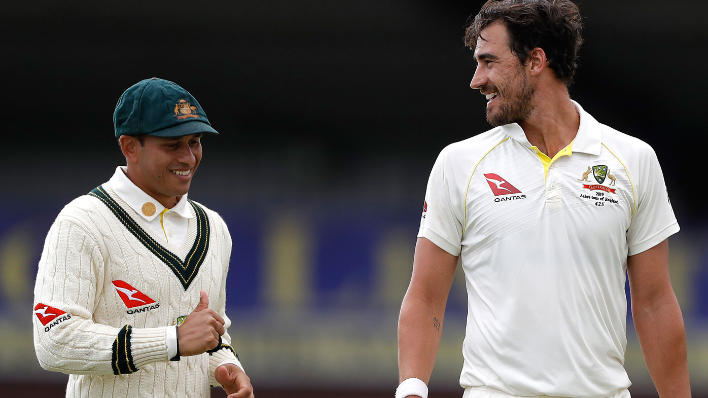 Mitchell Starc of Australia speaks to Usman Khawaja during day one of the Tour Match between Derbyshire CCC and Australia