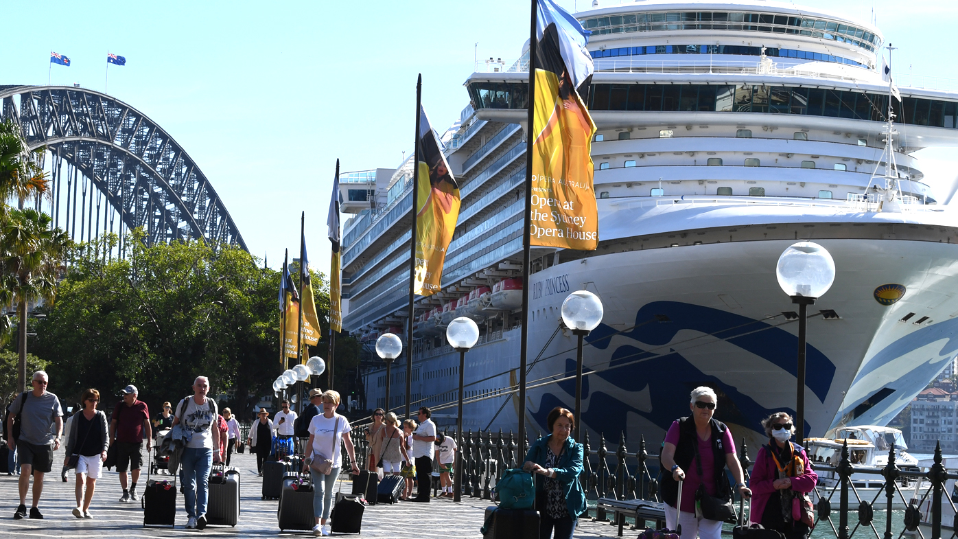 Cruise ship passengers disembark from the Ruby Princess at Circular Quay in Sydney, on March 19.