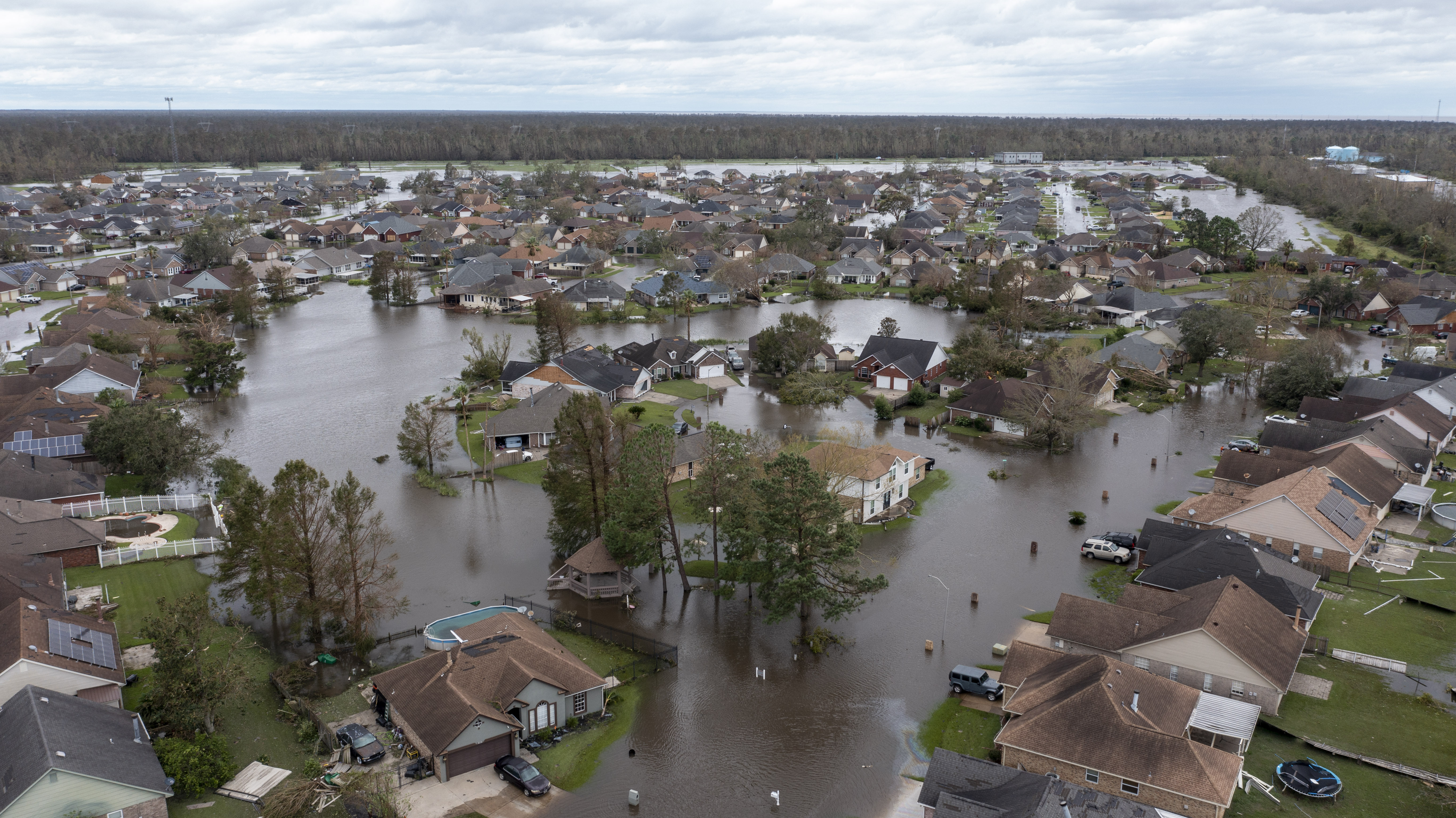 Flooded streets and homes are shown in the Spring Meadow subdivision in LaPlace, Louisiana after Hurricane Ida.