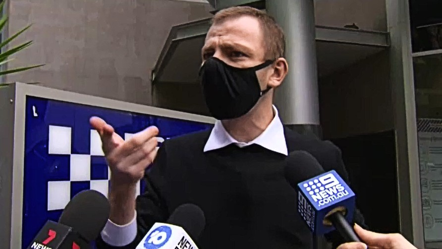 Tim Warburton, 32, pleaded guilty to wilful damage in Brisbane Magistrates Court this morning after his friend, Ryan Mitchem, broadcast the disrespectful act on social media on June 29.