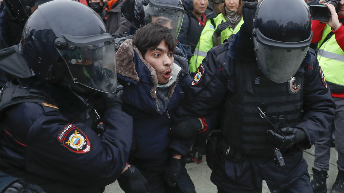 Police detain a man during a protest against the jailing of opposition leader Alexei Navalny in Moscow, Russia, Saturday, Jan. 23, 2021