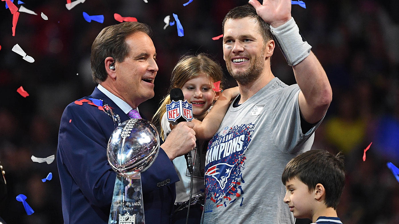Brady celebrates with the Vince Lombardi Trophy