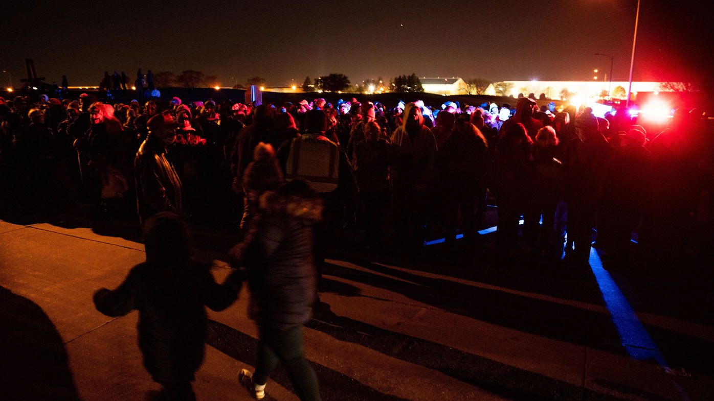 Thousands wait for shuttle buses following a Make America Great Again! campaign rally with President Donald Trump in Omaha.