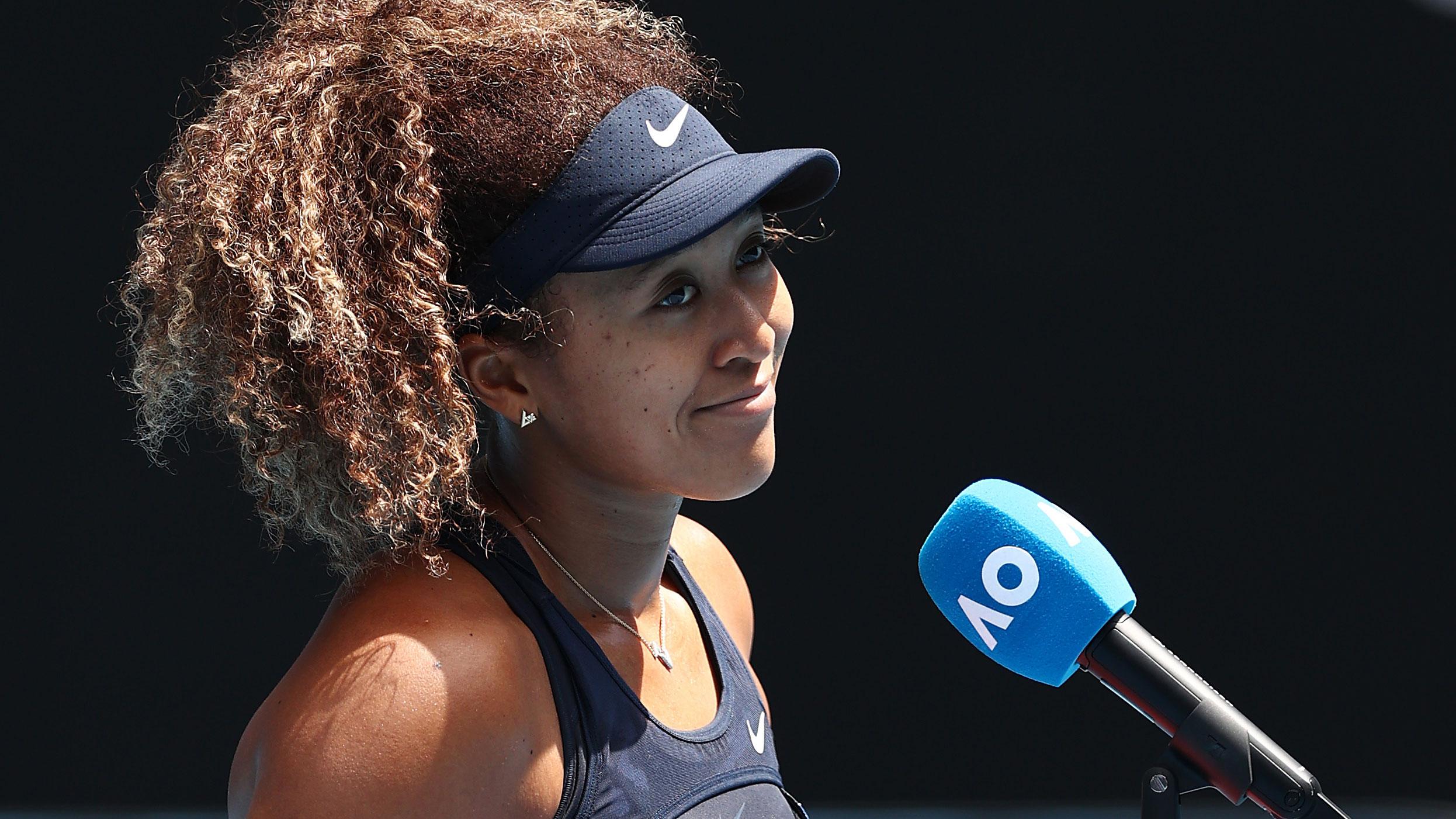 Naomi Osaka is interviewed after winning her Australian Open quarter-final.