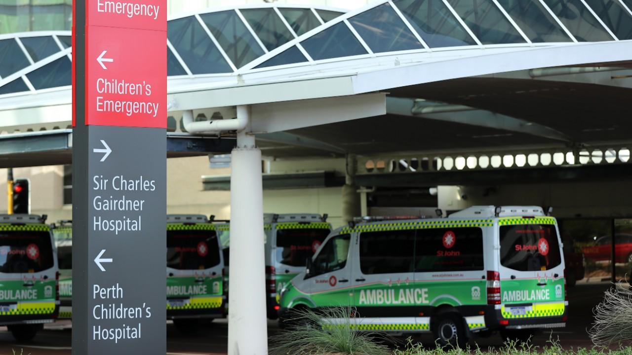 Ambulances parked outside the Sir Charles Gairdner Hospital in Perth where a man has died from coronavirus.