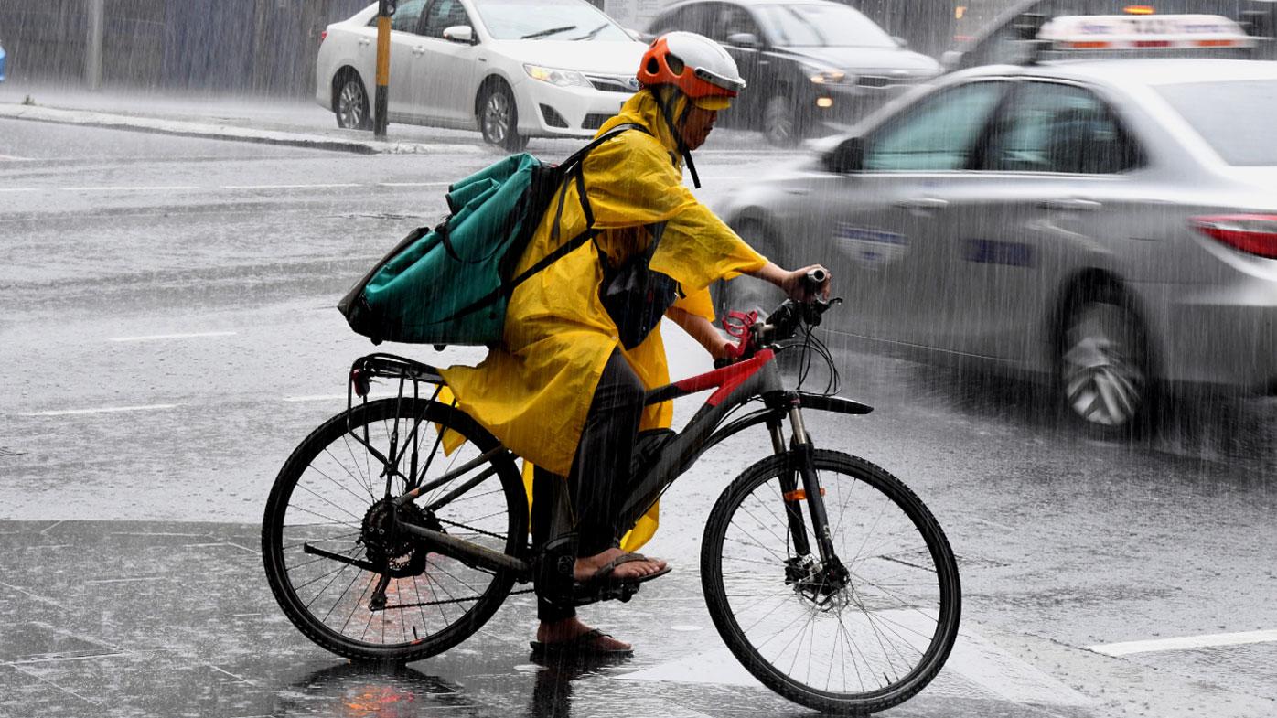 A cyclist battles the rain in Sydney.