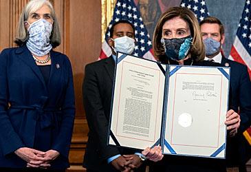 Nancy Pelosi with impeachment documents (Getty)