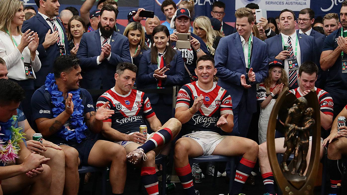 Cooper Cronk is honoured by his teammates in the locker room after the Sydney Roosters won the NRL grand final