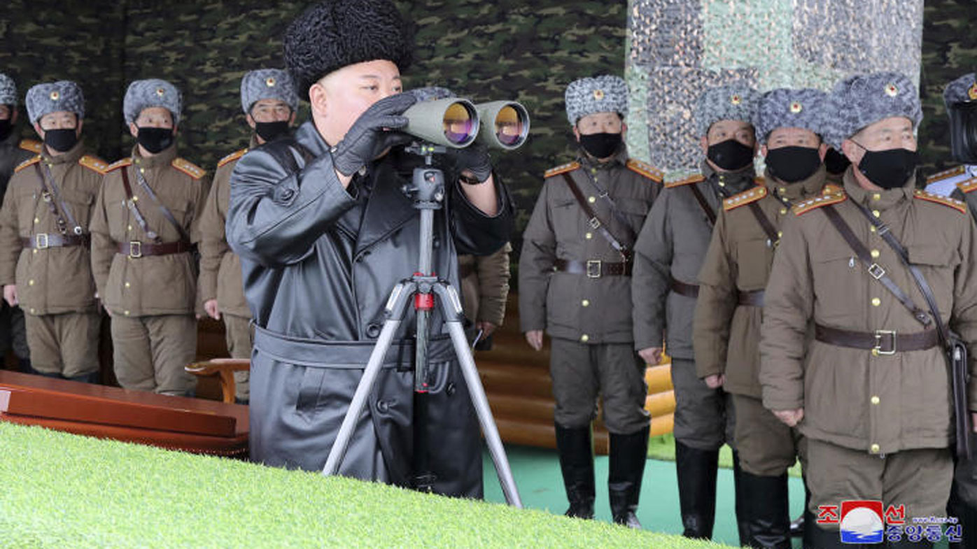 In a photo provided by the North Korean government, North Korean leader Kim Jong Un, inspects the military drill of units of the Korean People's Army, with soldiers shown wearing face masks.