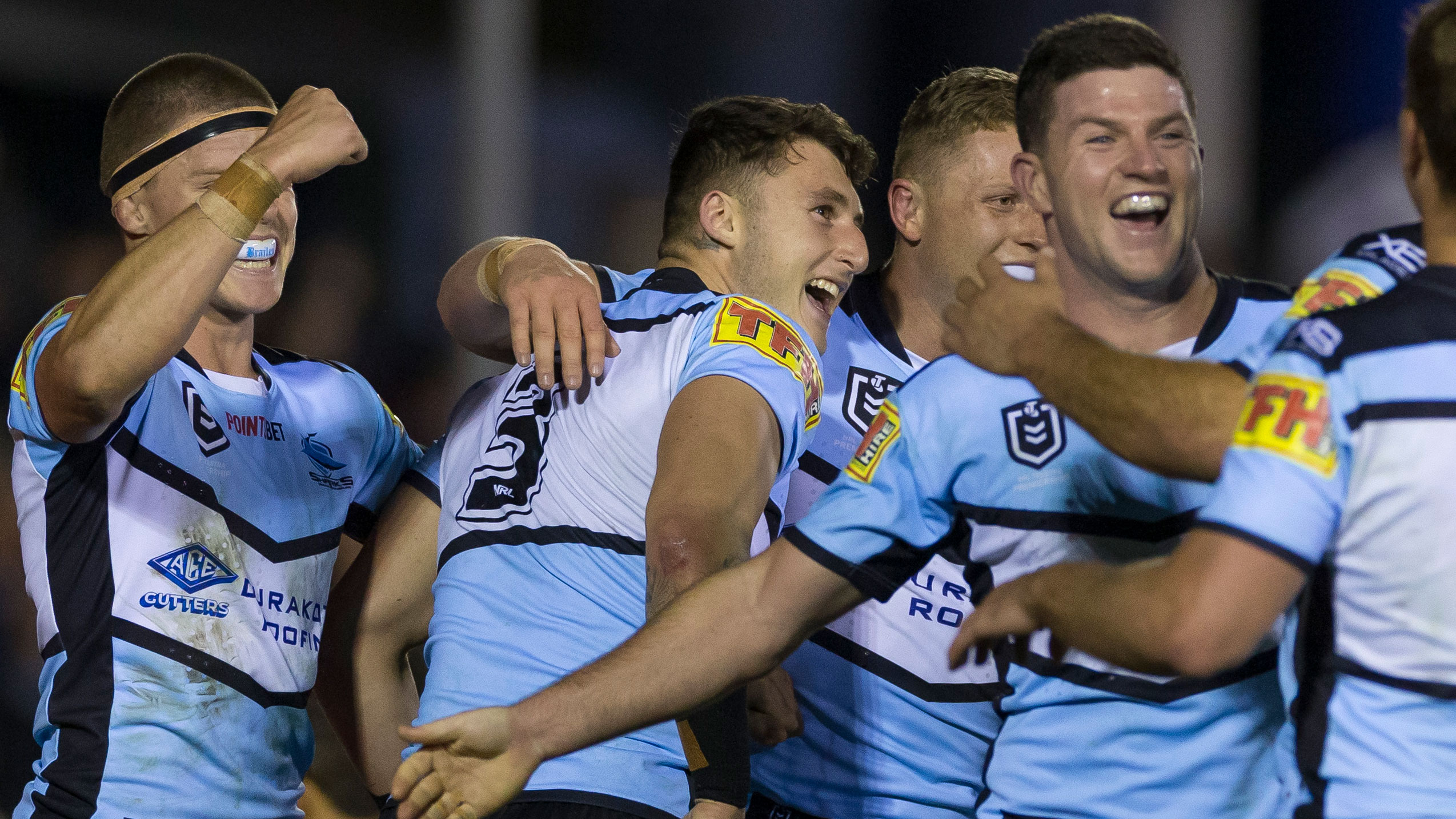 The Cronulla Sharks celebrate a try against the Rabbitohs.