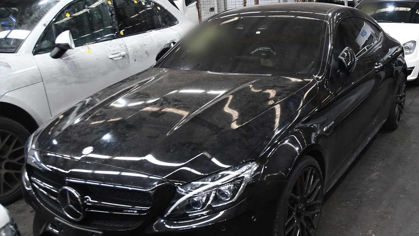 At least nine stolen luxury cars have been seized, some modified at a Summer Hill workshop.