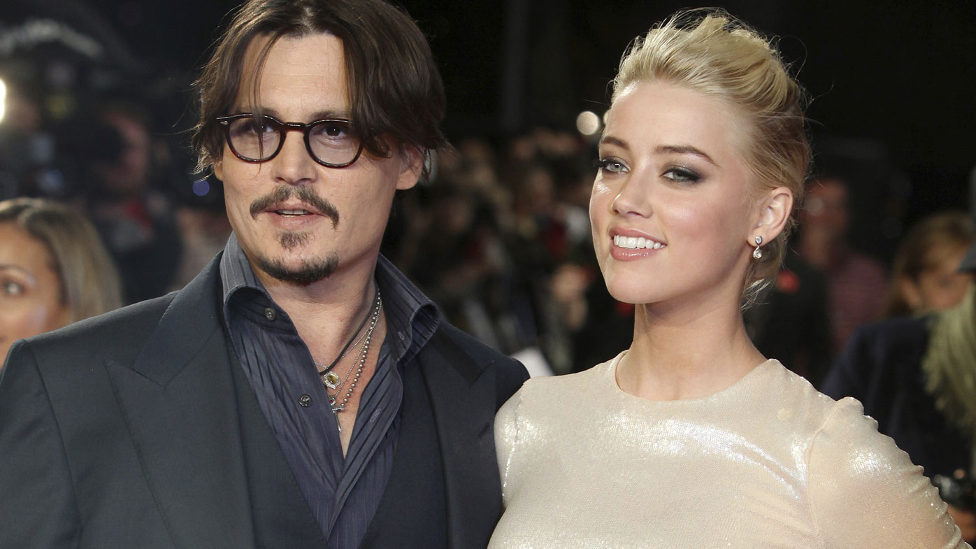 """In this Nov. 3, 2011 file photo, U.S. actors Johnny Depp, left, and Amber Heard arrive for the European premiere of their film, """"The Rum Diary,"""" in London"""