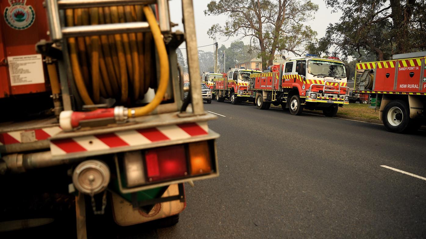 Fire crews outside the Eurobodalla Operations Fire Control Centre.