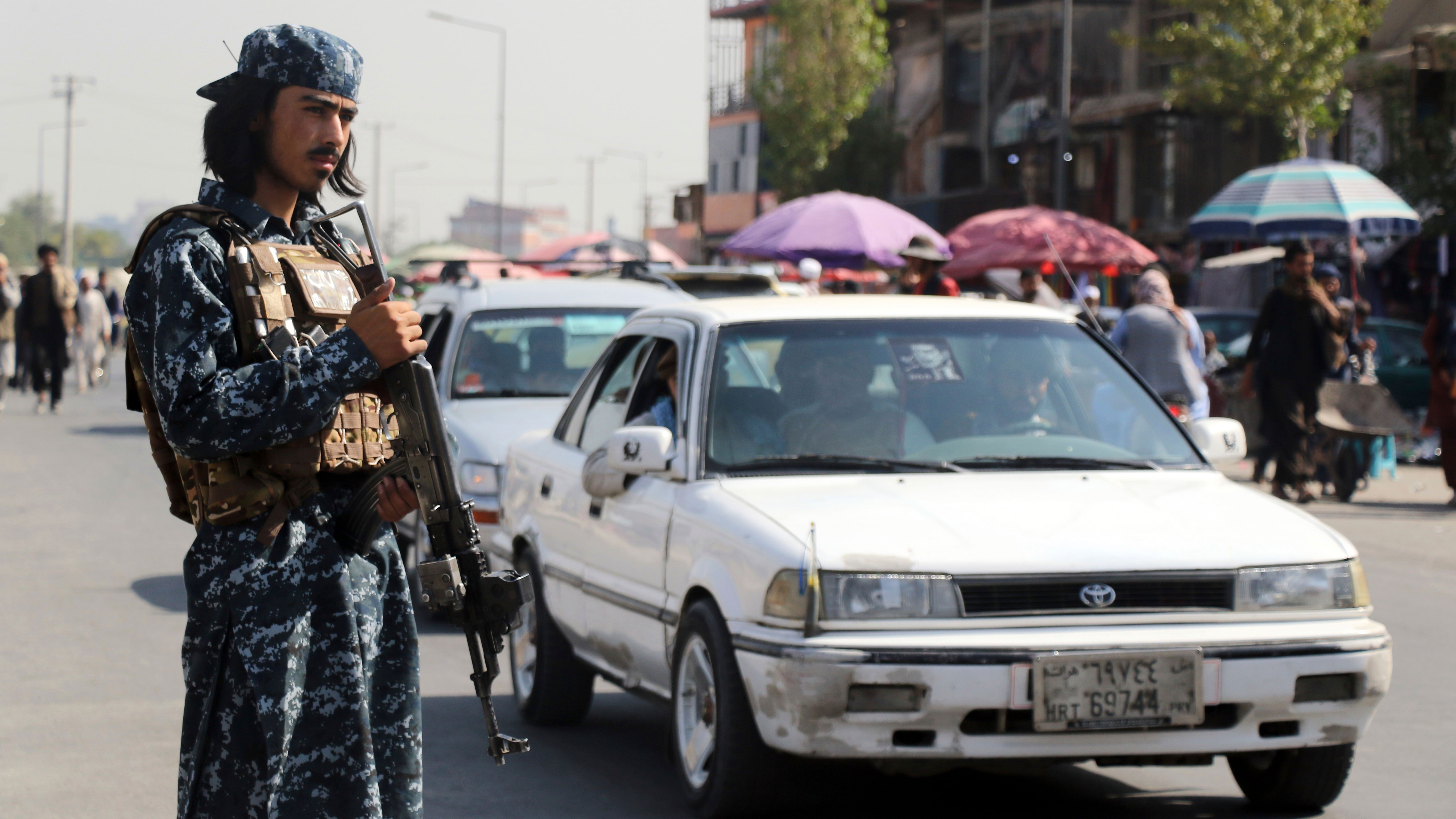 Taliban fighter stand guards in the city of Kabul, Afghanistan.