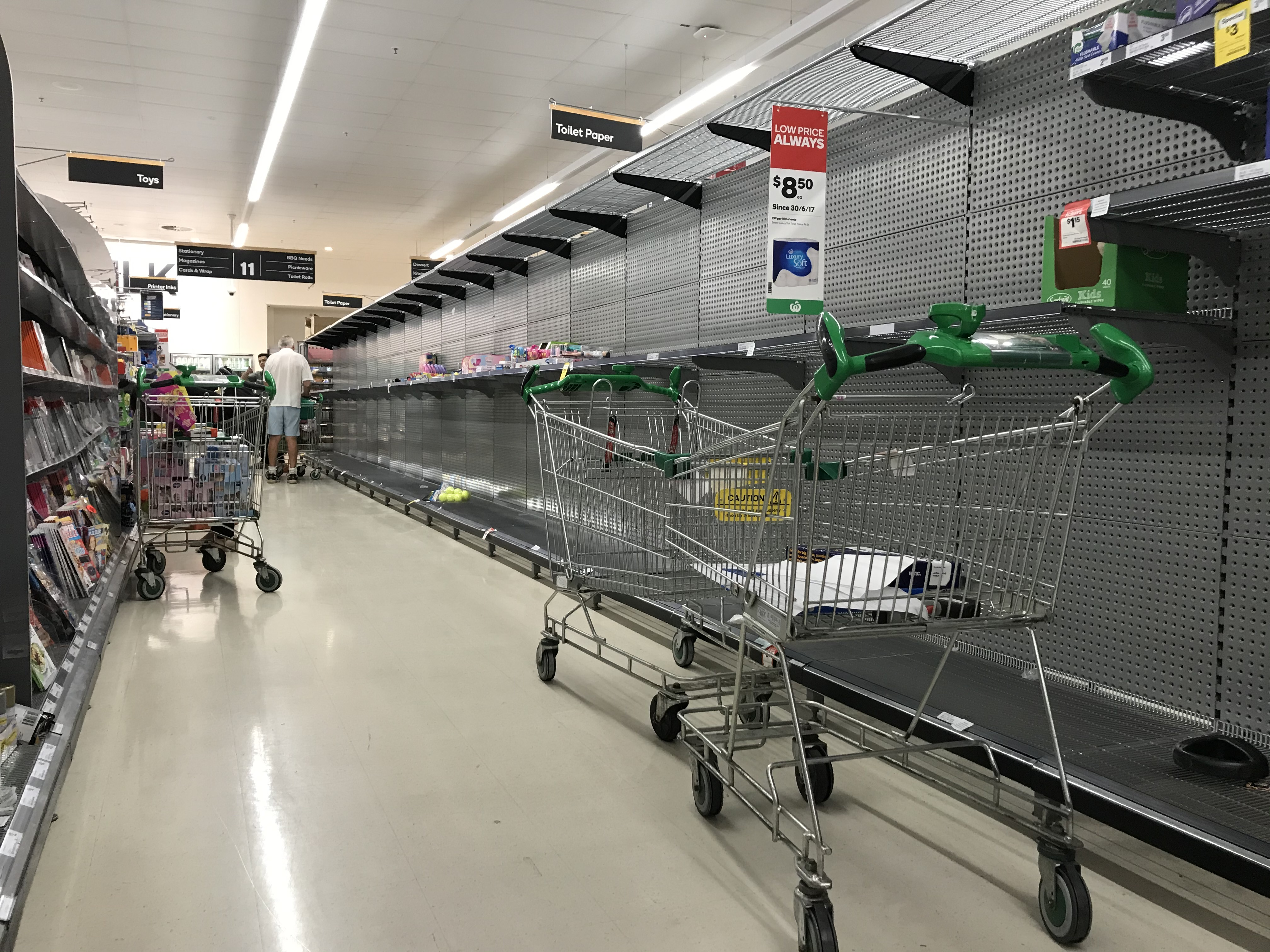 A supermarket in Double Bay with bare shelves as shoppers prepare for the worst.