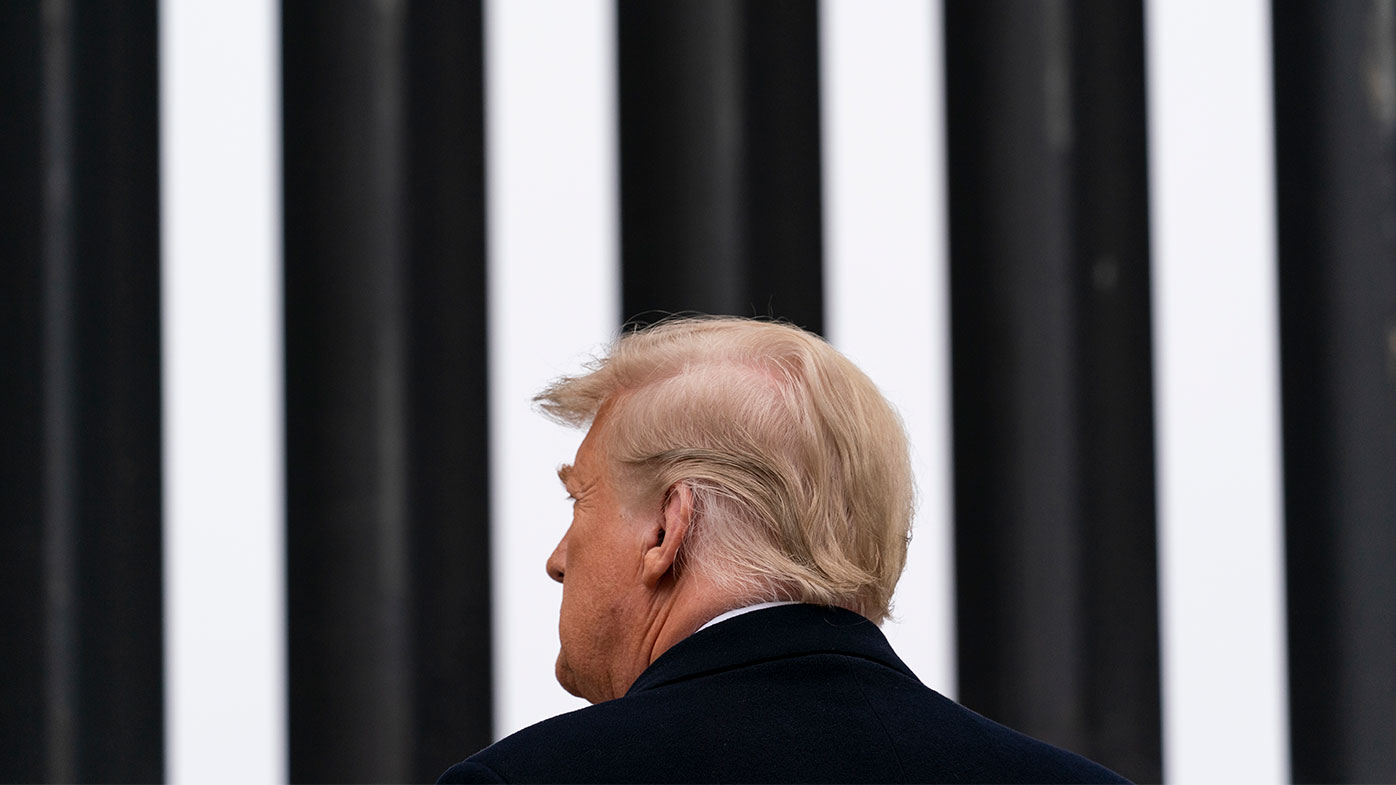 Then-President Donald Trump tours a section of the U.S.-Mexico border wall in Alamo, Texas.