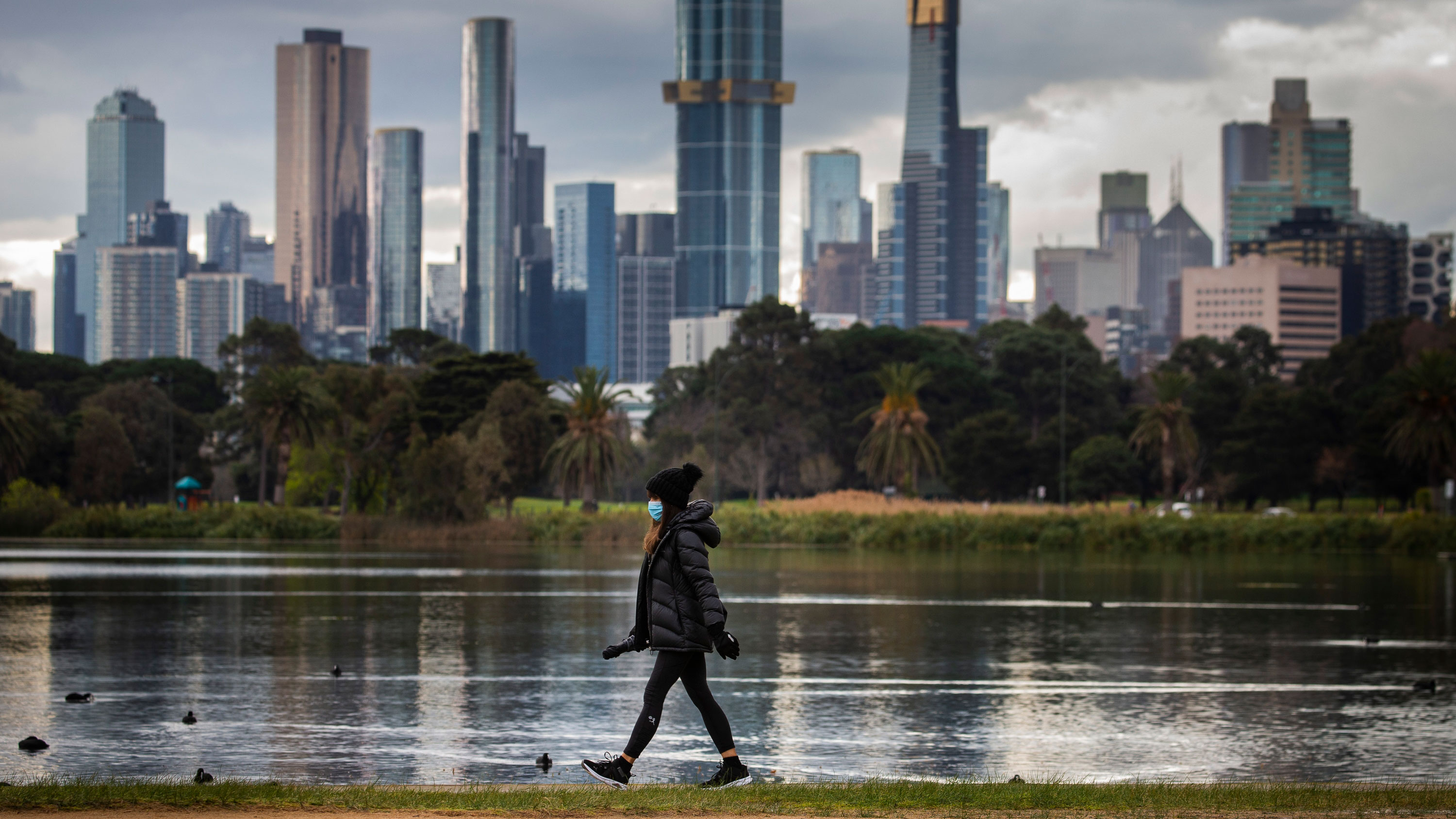 Stormy skies are seen over Melbourne from Albert Park Lake.