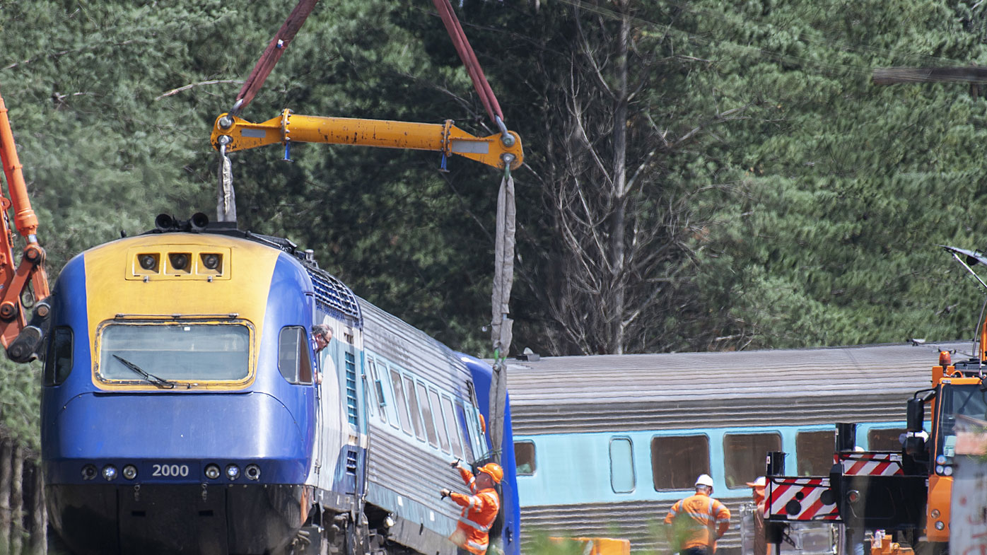 A sling on a crane is used to move part of the XPT train that derailed in Wallan North, 45km north of Melbourne, Sunday, February 23, 2020.