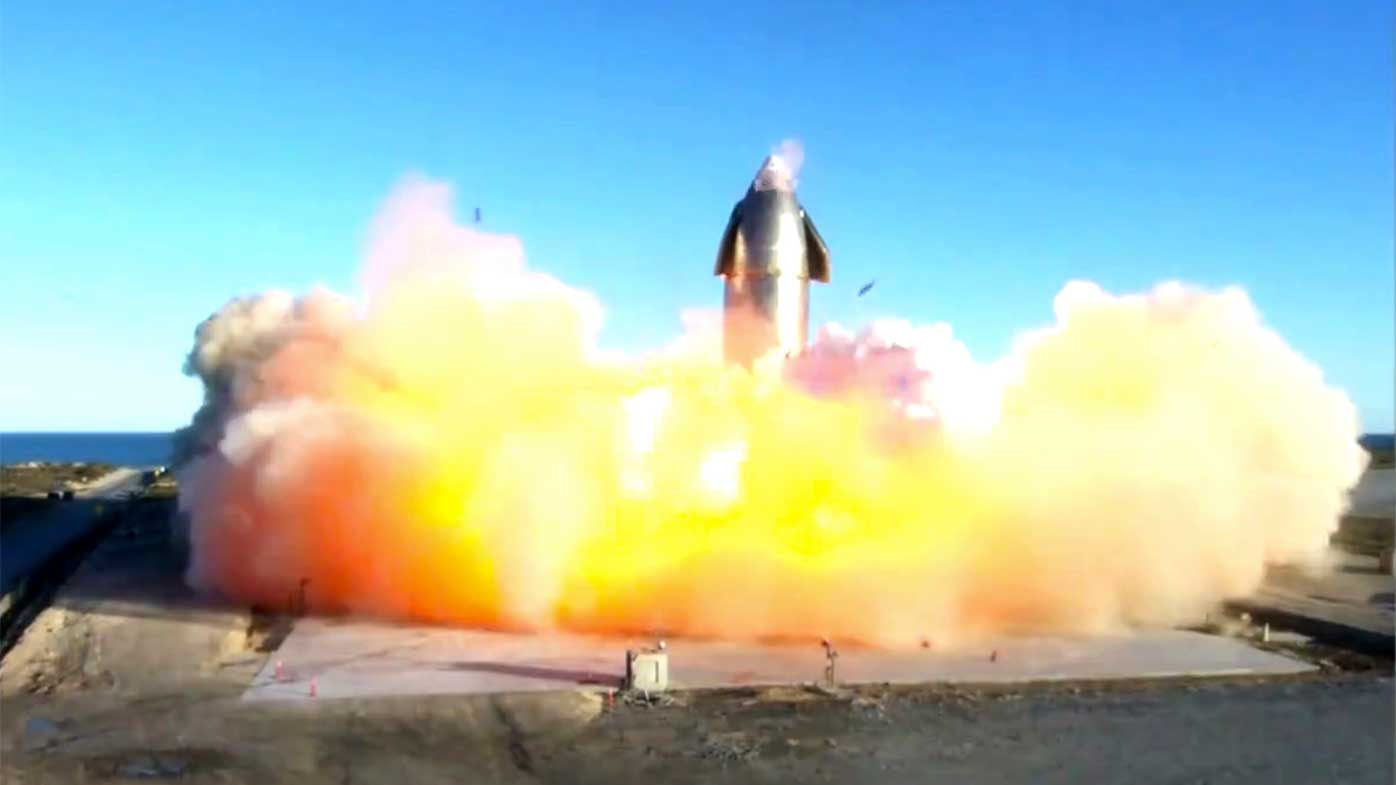In this image taken from video posted by SpaceX, the company's Starship becomes engulfed in flames and ruptures upon touching down after a test flight.