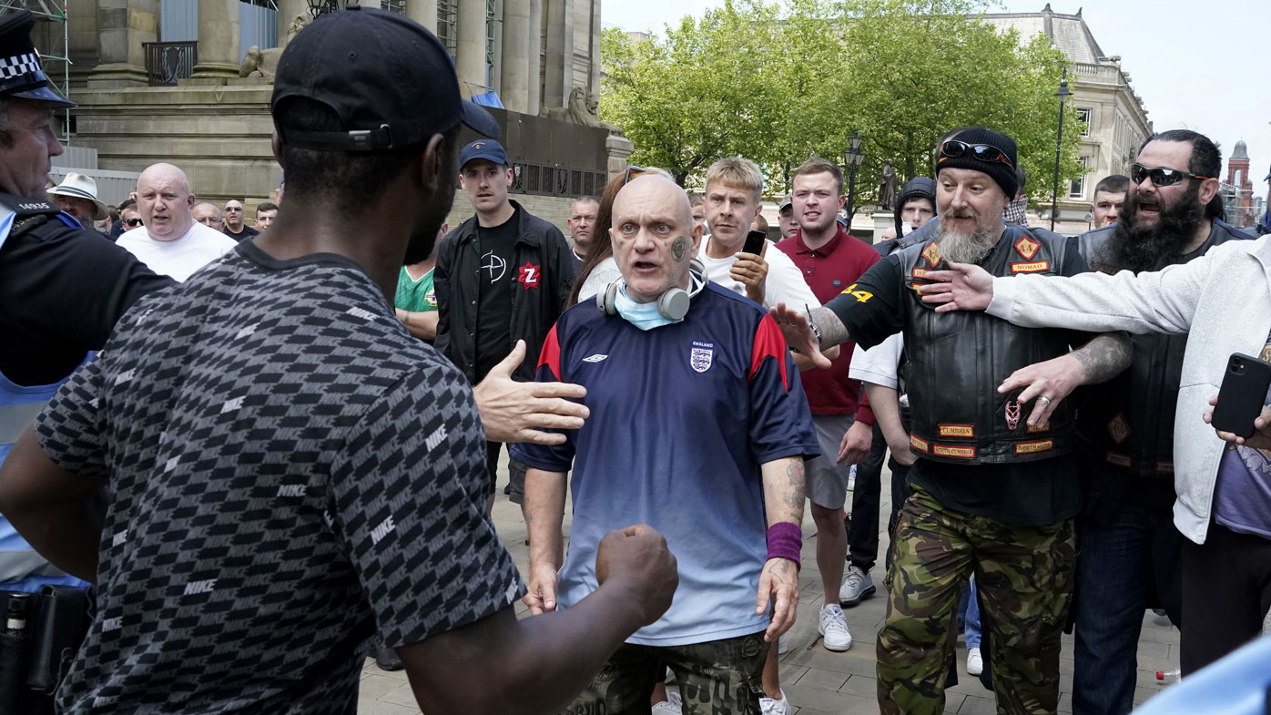 """A group referring to themselves as """"patriots"""" clash with anti-racism protesters at the Cenotaph during a Black Lives Matter protest on June 13, 2020 in Manchester, England."""