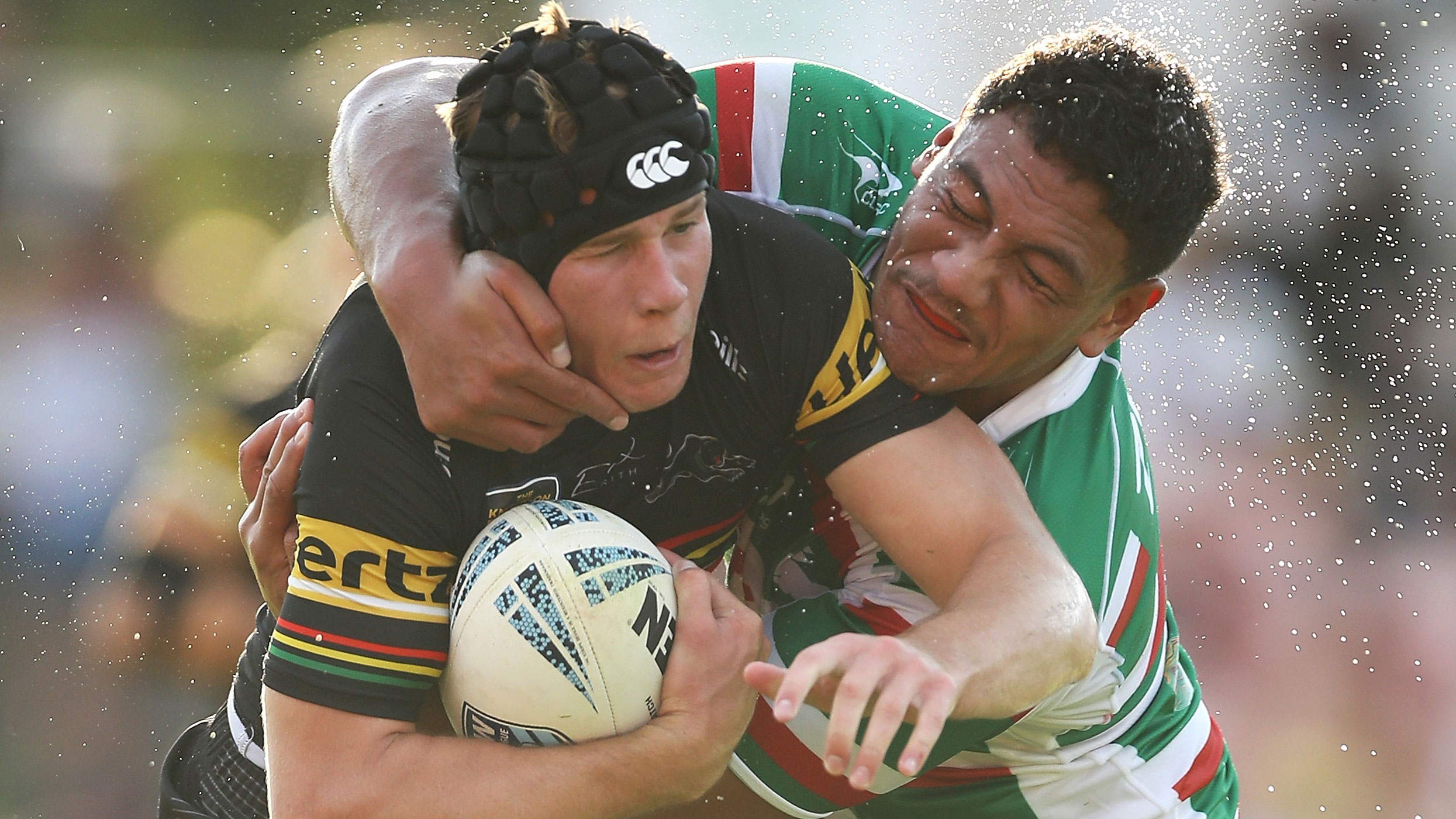 Matt Burton is tackled by a Souths player in NSW Cup.