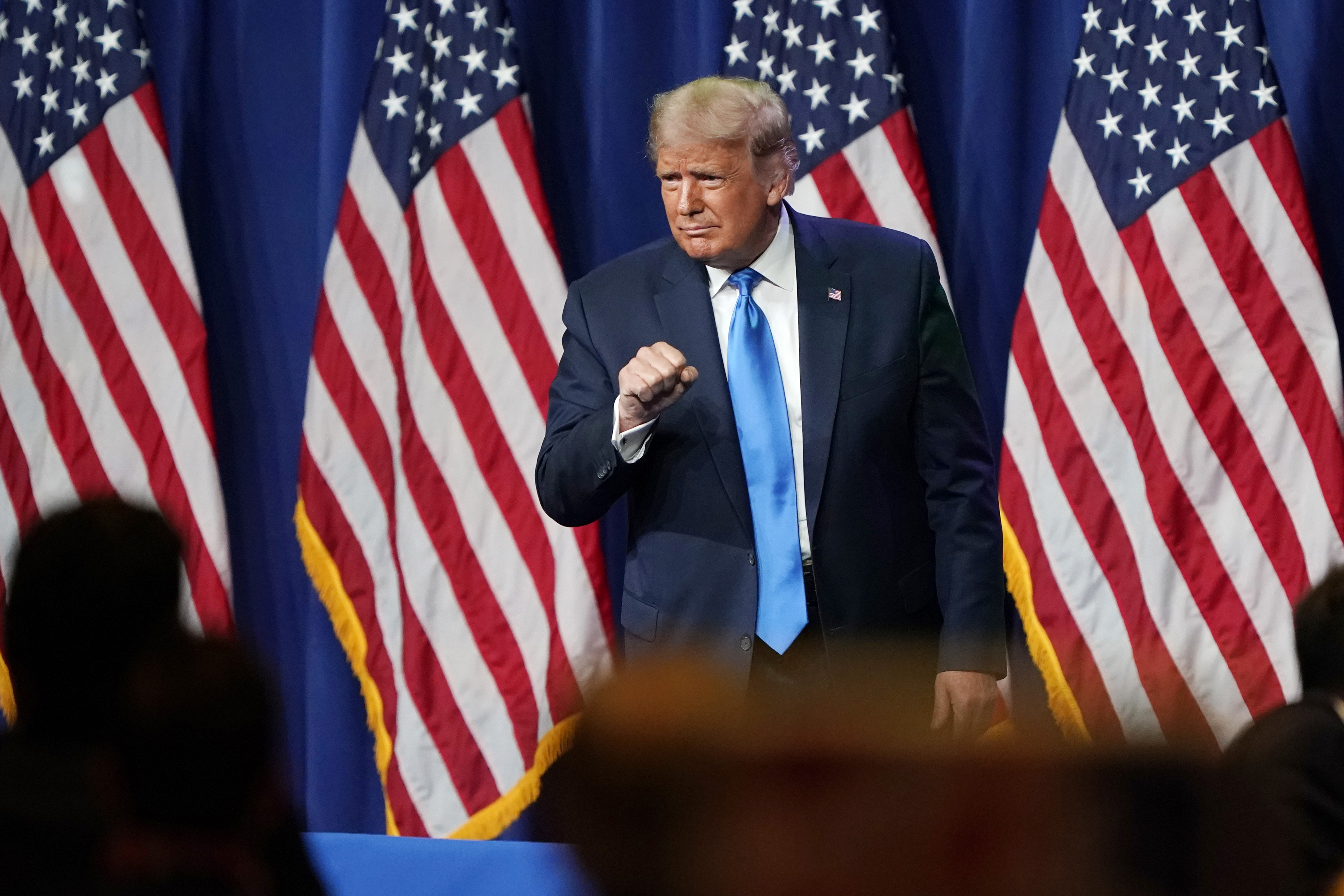 President Donald Trump interacts with the crowd after speaking during the first day of the Republican National Convention