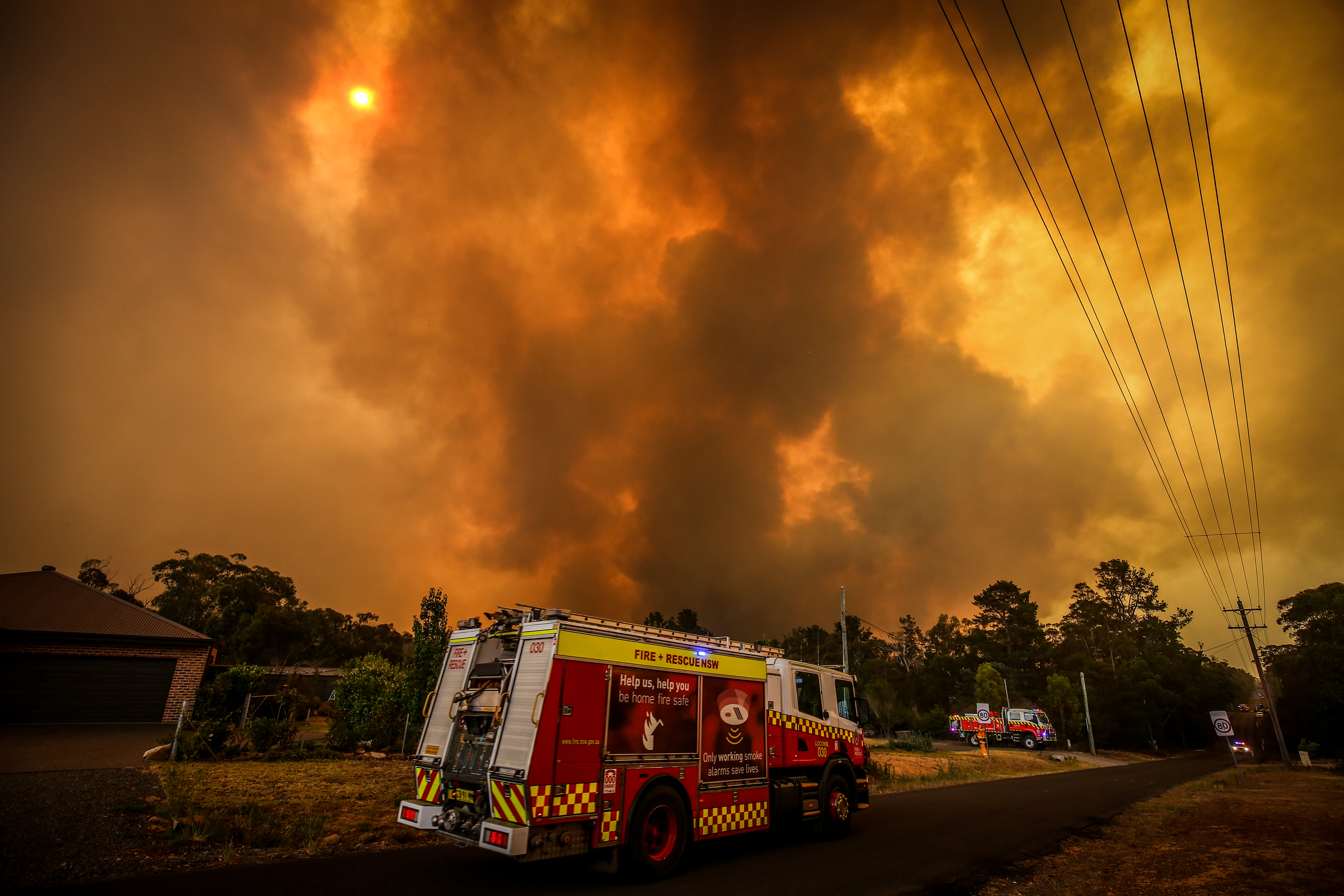 A bushfire approaches homes on the outskirts of the town of Bargo on December 21, 2019.